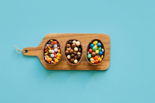 Chocolate eggs with pellets on board