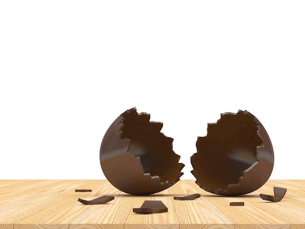 木の床にチョコレートの空の壊れた卵の殻