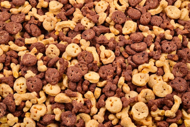 Chocolate flakes in the form of skulls and bones background. top view.