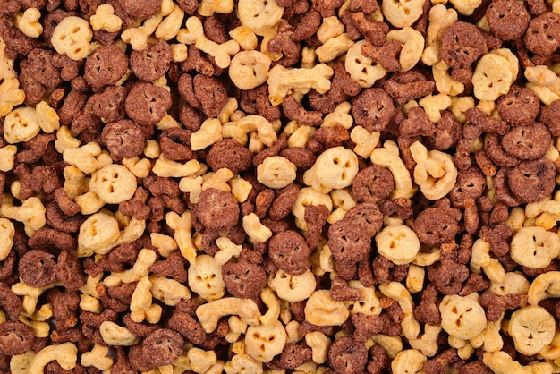 Chocolate flakes in the form of skulls and bones background