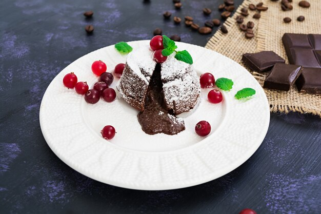 Chocolate fondant with cranberry sauce.