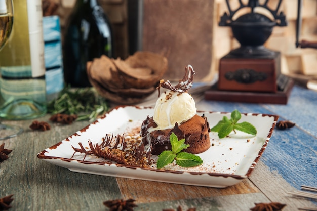 Chocolate fondant with ice cream mint and garnish