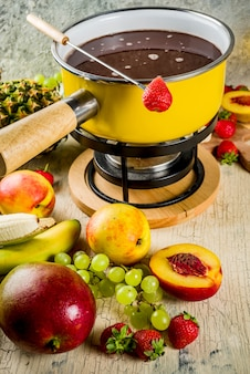 Chocolate fondue with fruit and berry