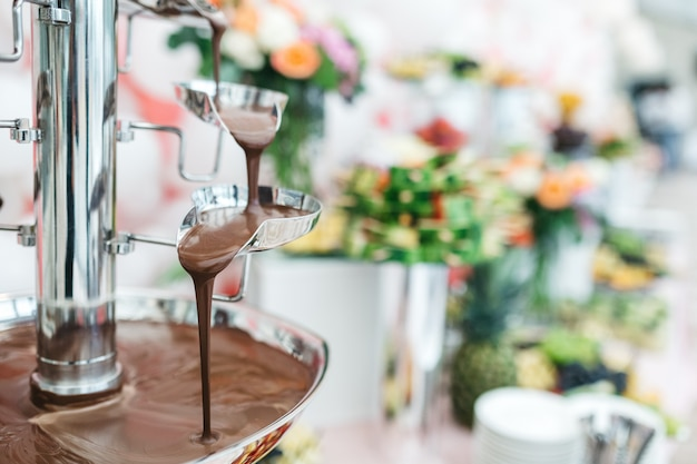 Chocolate fountain in a restaurant for celebrating guests