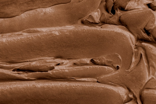 Chocolate frosting texture background close-up