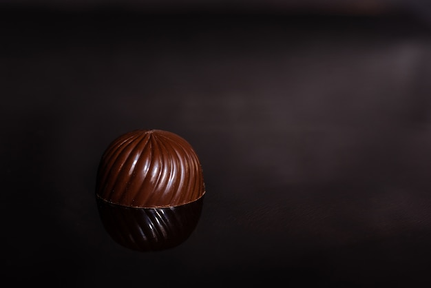Chocolate on glass with reflection.