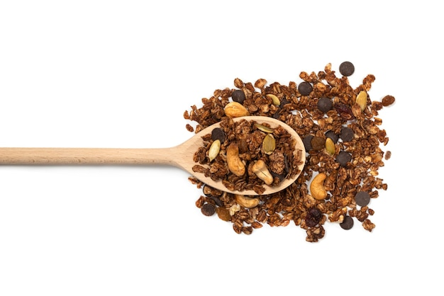 Chocolate granola cereal with nuts in a wooden spoon. isolated on white bacckground.