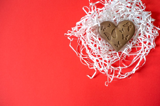 Chocolate heart with butterflies. valentine's day. heart shaped chocolate