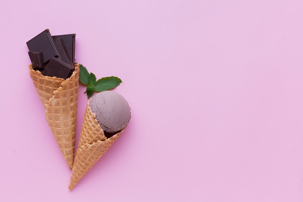 Chocolate ice cream on pink background