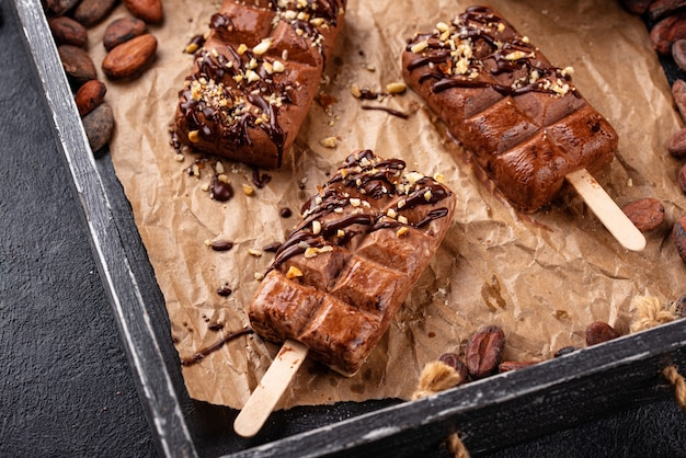 Chocolate ice cream popsicle with nut