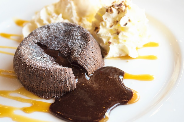 Chocolate lava cake in white plate