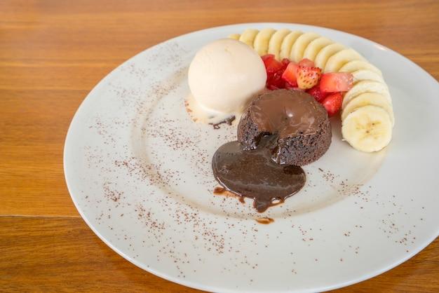 Chocolate lava cake with vanilla icecream, strawberry and banana topping