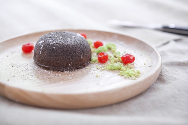 Chocolate lava on wooden plate