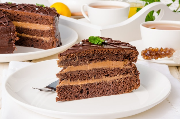 Chocolate layer cake with butter cream. traditional cake prague. russian cuisine