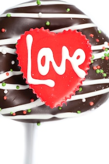 Chocolate of love in heart on white background.