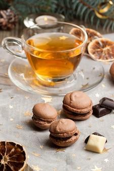 Chocolate macarons and cup of tea