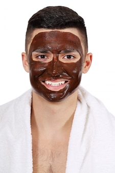 Chocolate mask on the man's face