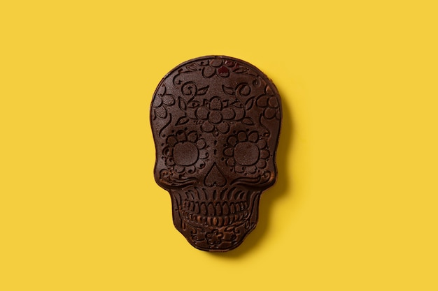 Chocolate mexican skull on yellow background