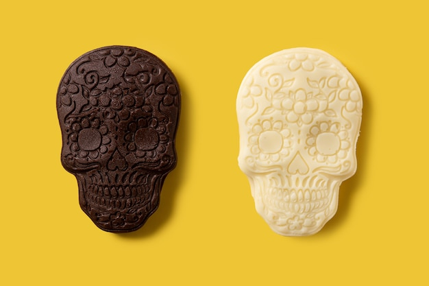 Chocolate mexican skulls pattern on yellow background