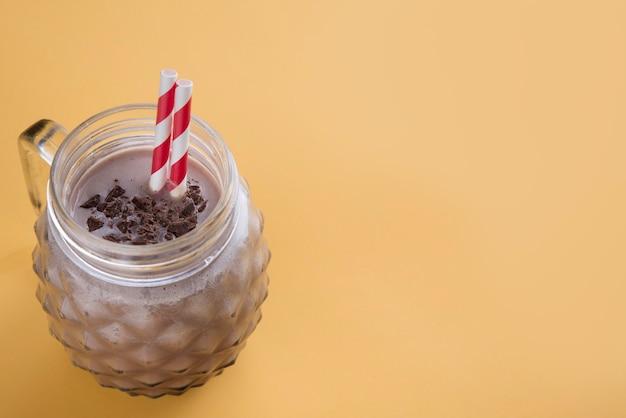Chocolate milkshake in color background
