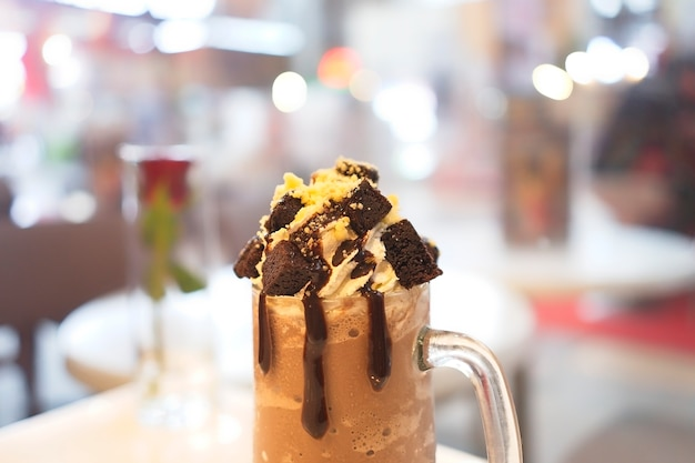 Chocolate milkshake with ice cream and whipped cream then topped with brownie