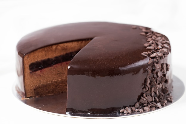 Chocolate mousse cake with currant jelly and mirror glaze