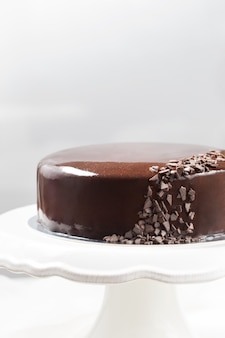 Chocolate mousse cake with mirror glaze on a cake stand