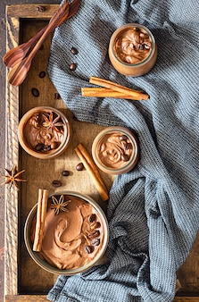 Chocolate mousse ceramic bowl with cinnamon and anise star