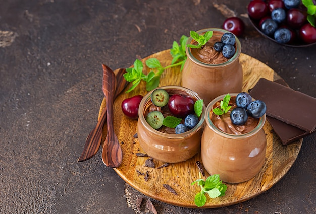 Chocolate mousse ceramic bowls with fresh fruits