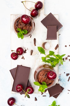 Chocolate mousse with mint and sweet cherries