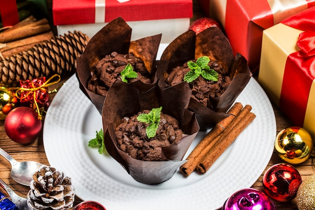 Chocolate muffin and branches fir. christmas time.