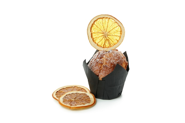 Chocolate muffin with orange slice isolated on white background.