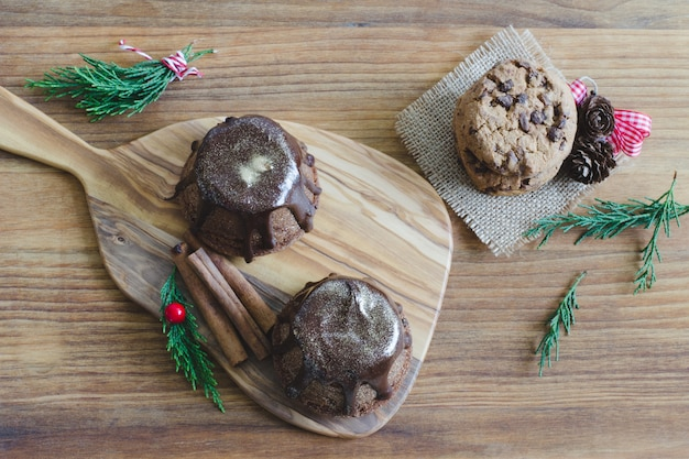 Chocolate muffin on wooden background.