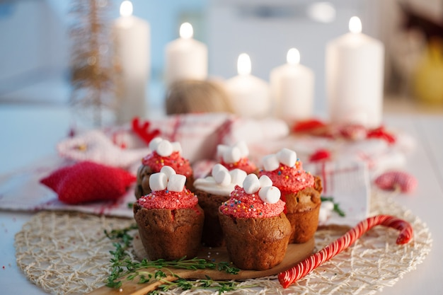 Chocolate muffins on table with candles and candies