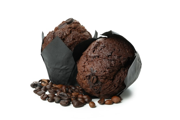 Chocolate muffins with coffee seeds isolated on white background.