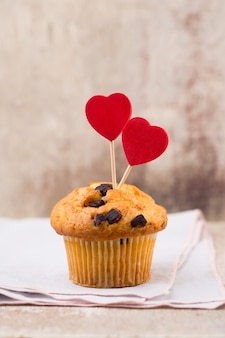 Chocolate muffins with heart vintage, selective focus.