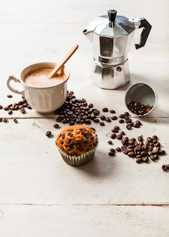Chocolate muffins with roasted coffee beans and espresso coffee