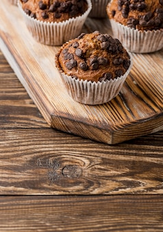 Chocolate muffins on wooden board high view