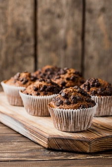 Chocolate muffins on wooden board