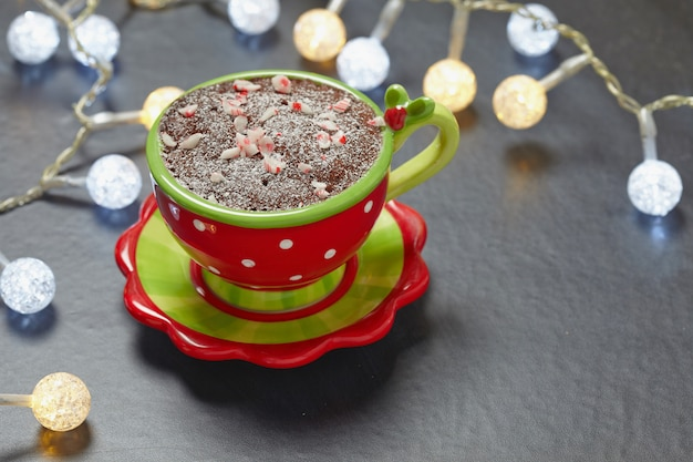 Chocolate mug cake with hazelnut paste and peppermint candy