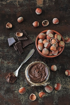 Chocolate nut paste and unpeeled hazelnuts.
