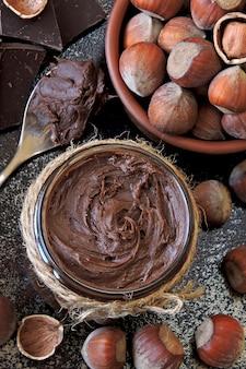 Chocolate nut paste and unpeeled hazelnuts.