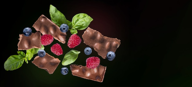 Chocolate nuts basil raspberry blueberry or blueberry meal snack on the table copy space food