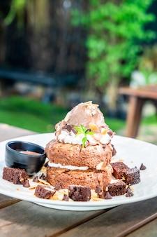 Chocolate pancake with chocolate ice-cream and brownies