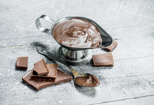 Chocolate paste in bowl. on a rustic table.