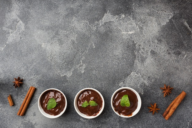 Chocolate paste with mint, cinnamon and anise on dark background