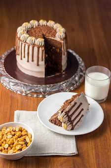 Chocolate and peanut cake. charge cake. on wooden background.