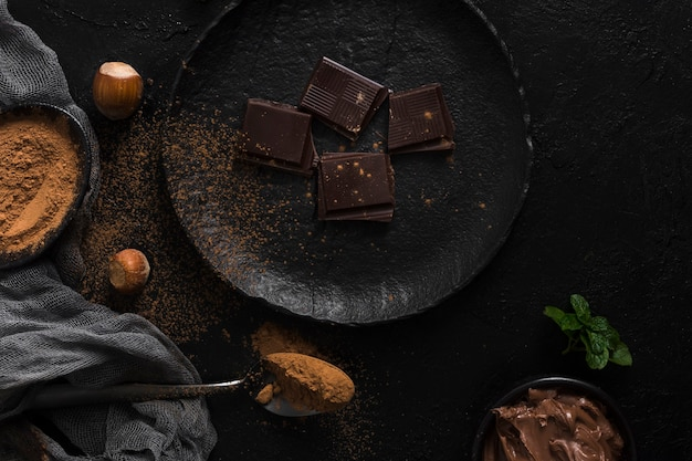 Chocolate pieces on plate flat lay