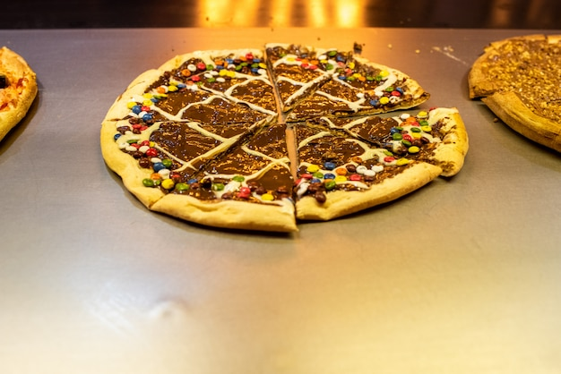 Chocolate pizzas and sweets in a restaurant.