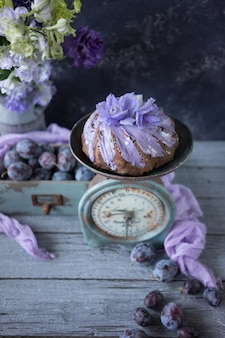 Chocolate plum cake with lilac flowers